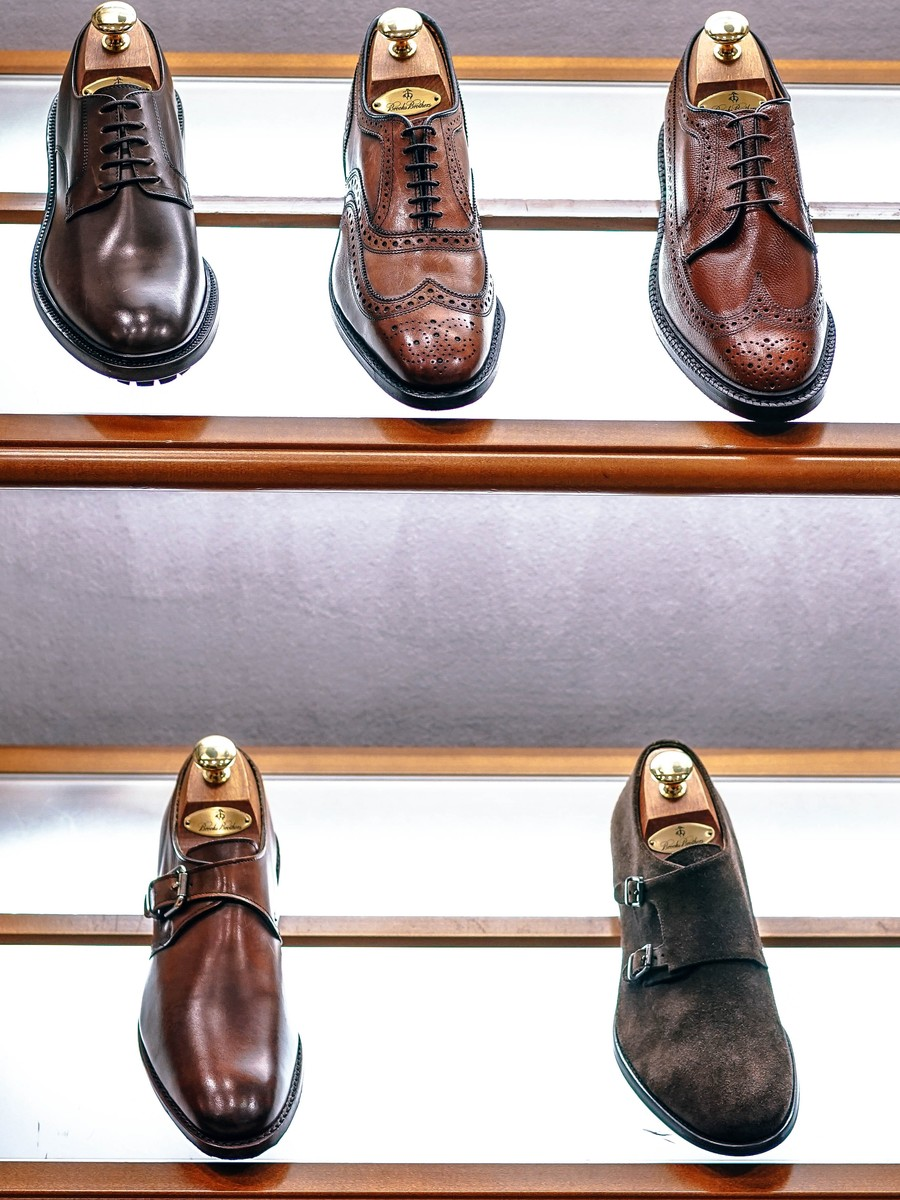 Rows of shiny new men's shoes